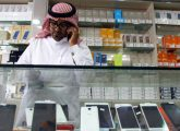A Saudi vendor speaks on his phone as he waits for customers at a mobile shop in Riyadh, Saudi Arabia March 21, 2016. REUTERS/Faisal Al Nasser