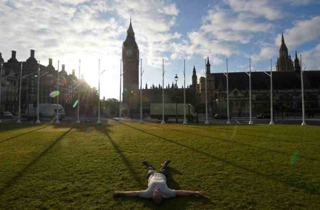 A man lies on the ground in Parliament Square in London, Britain June 24, 2016. REUTERS/Toby Melville