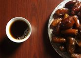 Cups of coffee and plate of dates.