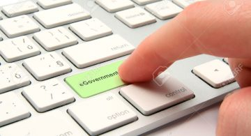 E-government-concept-modernized-computer-keyboard-with-e-government-keypad-Stock-Photo