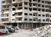 Aid ambulances in Daraya, a blockaded Damascus suburb, on Friday, Aug. 26, 2016. The development in the Daraya suburb is part of an agreement struck between the rebels and the government of President Bashar Assad. Rebels agreed to evacuate after four years of grueling bombardment and a crippling siege that has left the sprawling suburb southwest of the capital in ruins.(AP Photo)