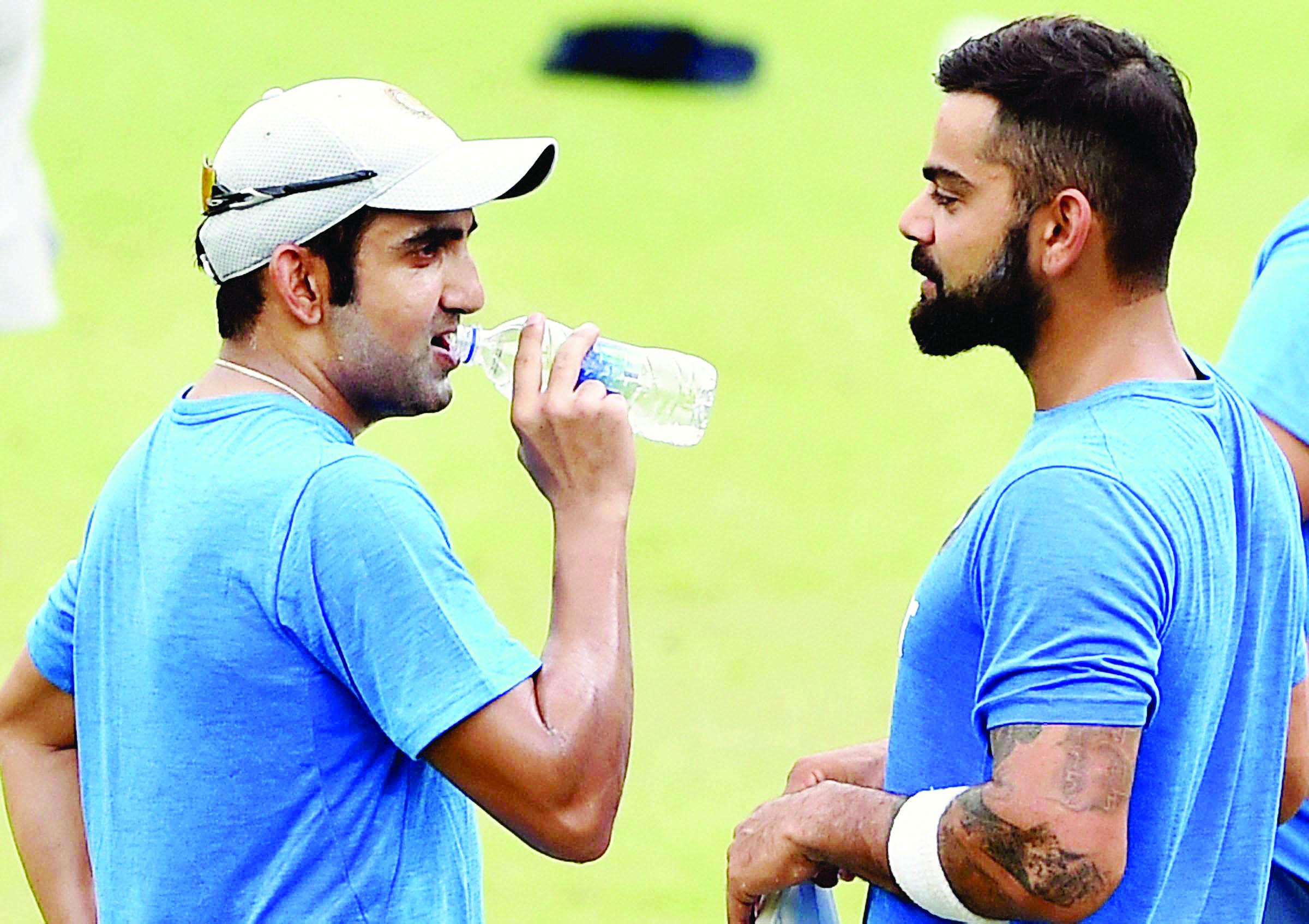 Kolkata: Virat Kohli and Gautam Gambhir  at a training session at Eden Garden in Kolkata on Thursday on the eve of 2nd Test Match against New Zealand. PTI Photo by Swapan Mahapatra (PTI9_29_2016_000119B)
