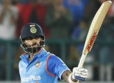 India's Virat Kohli raises his bats after scoring a half century against New Zealand during their first one-day international cricket match in Dharmsala, India, Sunday, Oct. 16, 2016. (AP Photo/Tsering Topgyal)