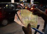notes-counted-at-petrol-pump-afp_650x400_81478673812