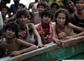 Rohingya migrants sit on a boat drifting in Thai waters off the southern island of Koh Lipe in the Andaman sea on May 14, 2015.  The boat crammed with scores of Rohingya migrants -- including many young children -- was found drifting in Thai waters on May 14, according to an AFP reporter at the scene, with passengers saying several people had died over the last few days.     AFP PHOTO / Christophe ARCHAMBAULT        (Photo credit should read CHRISTOPHE ARCHAMBAULT/AFP/Getty Images)