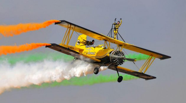Skycat Wingwalkers from the Scandinavian Airshow perform during the inauguration of Aero India show at the Yelahanka Air Force Station in Bengaluru, February 14, 2017. REUTERS/Abhishek N. Chinnappa