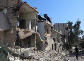 aleppo-syria-man-inspects-buildings-and-wreckage-follwing-barrell-bombs-by-regime