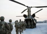 U.S. soldiers from the 3rd Cavalry Regiment load into a CH-47 Chinook helicopter for an advising mission to an Afghan National Army base at forward operating base Fenty in the Nangarhar province of Afghanistan